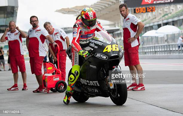 Valentino Rossi of Italy and Ducati Marlboro Team starts from the box during the first day of MotoGP Testing at Sepang Circuit on February 28 2012 in...