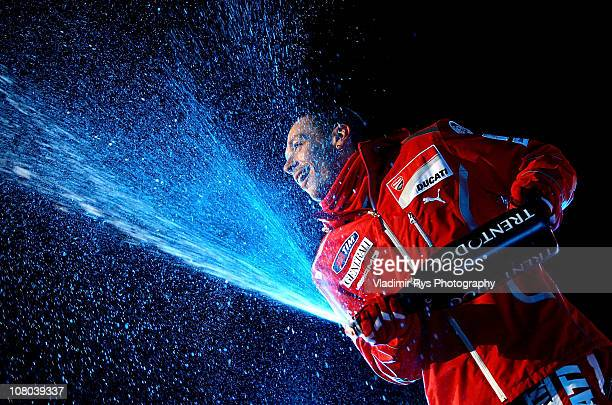 Valentino Rossi of Italy and Ducati sprays champagne after the final ice rink race during the 2011 Wroom F1 and Moto GP Press Ski Meeting on January...
