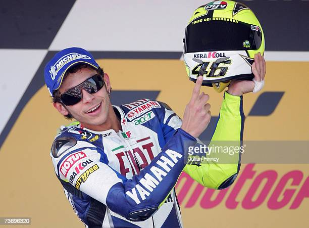 Valentino Rossi of Italy and Fiat Yamaha celebrates by pointing to his helmet after winning the MotoGP of Spain at the Circuito de Jerez on March 25...