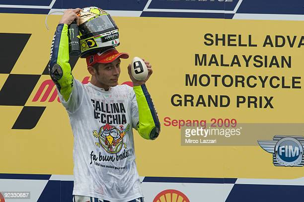 Valentino Rossi of Italy and Fiat Yamaha celebrates winning his ninth MotoGP World Championship title with his third place in the Malaysian MotoGP of...