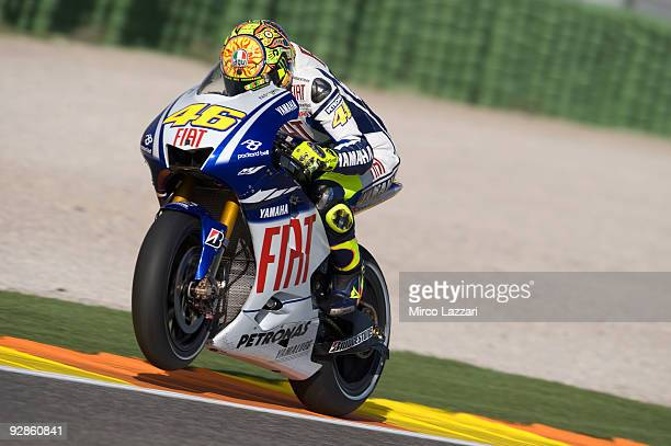 Valentino Rossi of Italy and Fiat Yamaha heads down a straight during the first free practice session ahead of the MotoGP of Valencia at the Valencia...