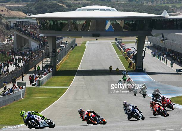 Valentino Rossi of Italy and Fiat Yamaha leads as Dani Pedrosa of Spain and Repsol Honda and Colin Edwards of Fiat Yamaha chase during the MotoGP of...