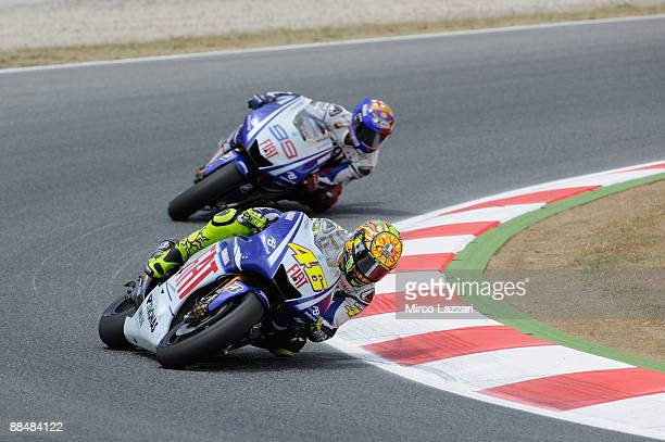 Valentino Rossi of Italy and Fiat Yamaha leads Jorge Lorenzo of Spain and Fiat Yamaha during the MotoGP at the Montmelo Circuit on June 14, 2009 in...