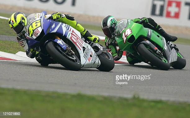 Valentino Rossi of Italy and Fiat Yamaha team and Randy De Puniet of France and Kawasaki Racing team in action during the Qualifying Practice at the...