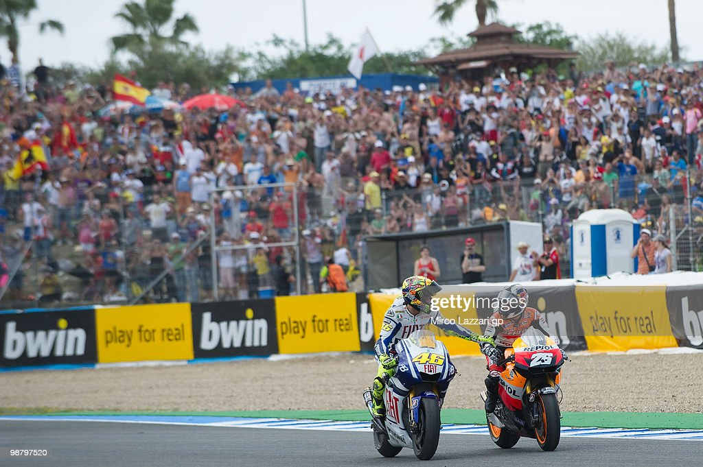 Valentino Rossi of Italy and Fiat Yamaha Team congratulates with Dani Pedrosa of Spain and Repsol Honda Team at the end of the MotoGP race at Circuito de Jerez on May 2, 2010 in Jerez de la Frontera, Spain.