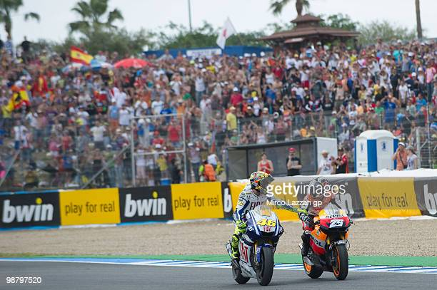 Valentino Rossi of Italy and Fiat Yamaha Team congratulates with Dani Pedrosa of Spain and Repsol Honda Team at the end of the MotoGP race at...