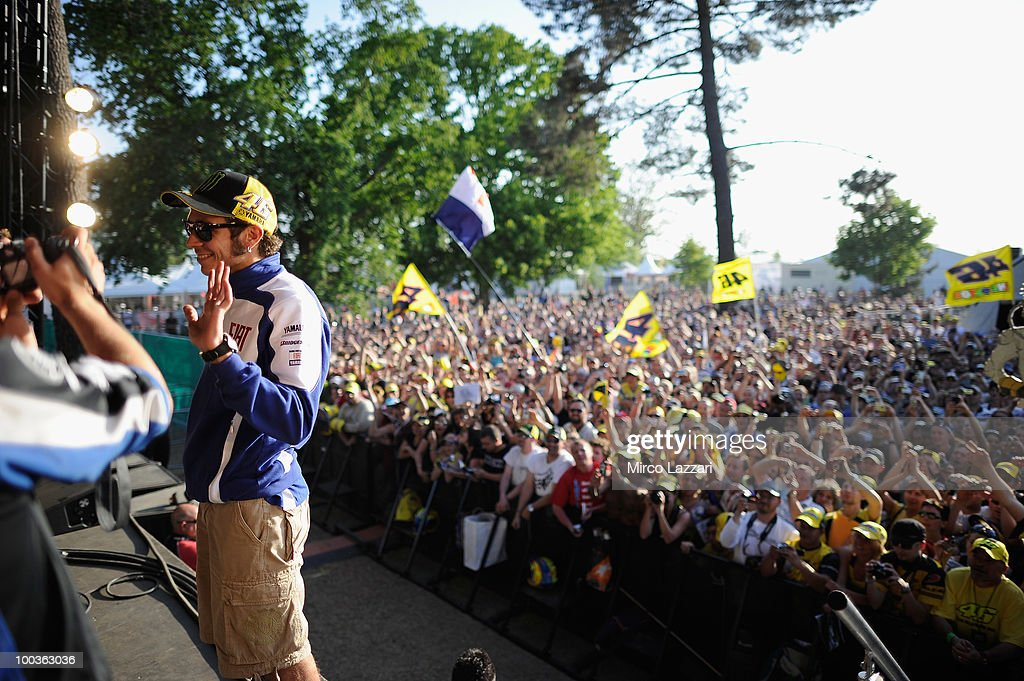 Valentino Rossi of Italy and Fiat Yamaha Team greets in front of the fans during the event 'Riders attend pubblic interviews on stage in front of fans' after the first free practice of the MotoGP French Grand Prix in Le Mans Circuit on May 21, 2010 in Le Mans, France.