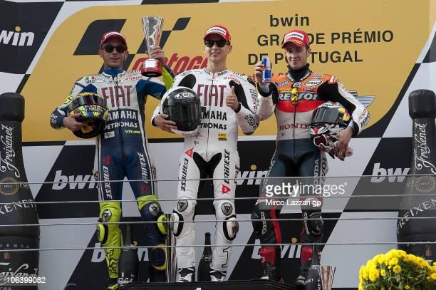 Valentino Rossi of Italy and Fiat Yamaha Team Jorge Lorenzo of Spain and Fiat Yamaha Team and Andrea Dovizioso of Italy and Repsol Honda Team...