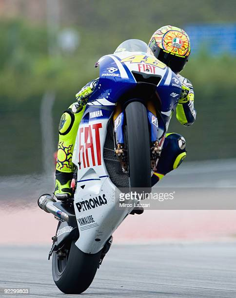 Valentino Rossi of Italy and Fiat Yamaha Team lifts the front wheel during the free practice for the Malaysian MotoGP which is round 16 of the MotoGP...