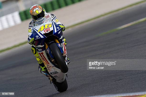Valentino Rossi of Italy and Fiat Yamaha Team lifts the front wheel during testing at the Valencia Circuit on November 10 2009 in Valencia Spain