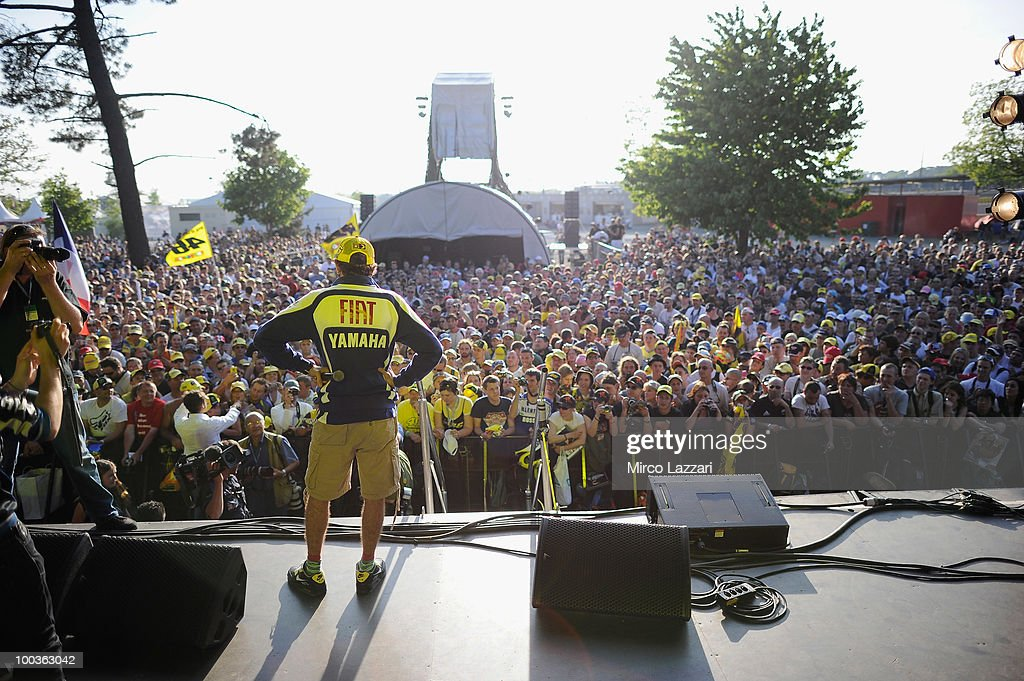 Valentino Rossi of Italy and Fiat Yamaha Team looks on the fans during the event 'Riders attend pubblic interviews on stage in front of fans' after the first free practice of the MotoGP French Grand Prix in Le Mans Circuit on May 21, 2010 in Le Mans, France.