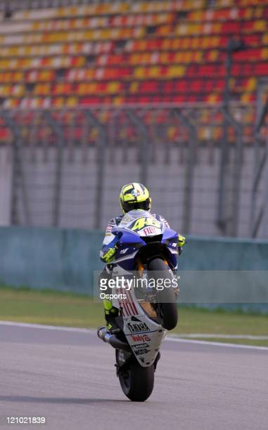 Valentino Rossi of Italy and Fiat Yamaha team performs a wheelie as he finishes the Qualifying Practice at the 2007 Motorcycle Grand Prix of China at...