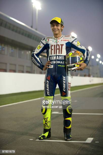 Valentino Rossi of Italy and Fiat Yamaha Team poses on the track during the official photo for the start of the season during the second day of...
