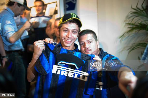 Valentino Rossi of Italy and Fiat Yamaha Team poses with the 'Inter Milan football tshirt' in order to celebrate the qualifying of Inter Milan for...