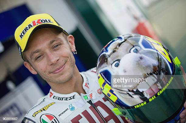 Valentino Rossi of Italy and Fiat Yamaha Team poses with the new helmet before the qualifying practice of the Gran Premio Cinzano di San Marino e...