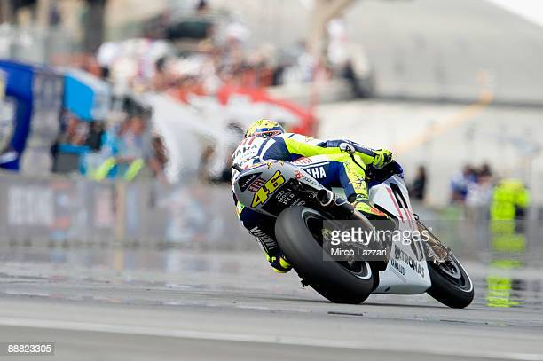 Valentino Rossi of Italy and Fiat Yamaha Team rounds the bend during qualifying practice for MotoGP World Championship US GP at at Mazda Raceway...