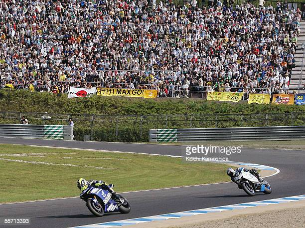Valentino Rossi of Italy and Makoto Tamada of Japan in action during the Japanese Grand Prix of the 2005 MotoGP World Championships at Motegi Twin...