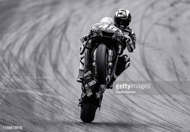 Valentino Rossi of Italy and Monster Energy Yamaha MotoGP pulls a wheelie after the first MotoGP free practice session ahead of MotoGP Gran Premi...