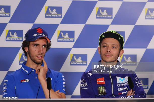 Valentino Rossi of Italy and Movistar Yamaha MotoGP and Alex Rins of Spain and Team Suzuki ECSTAR look on during the press conference during the...