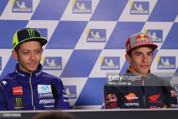 Valentino Rossi of Italy and Movistar Yamaha MotoGP and Marc Marquez of Spain and Repsol Honda Team look on during the press conference during the...