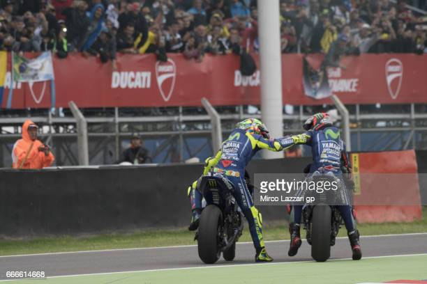 Valentino Rossi of Italy and Movistar Yamaha MotoGP and Maverick Vinales of Spain and Movistar Yamaha MotoGP celebrate at the end of the MotoGP race...