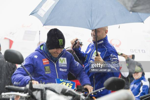 Valentino Rossi of Italy and Movistar Yamaha MotoGP arrives at the press conference during the MotoGp of Germany Preview at Sachsenring Circuit on...