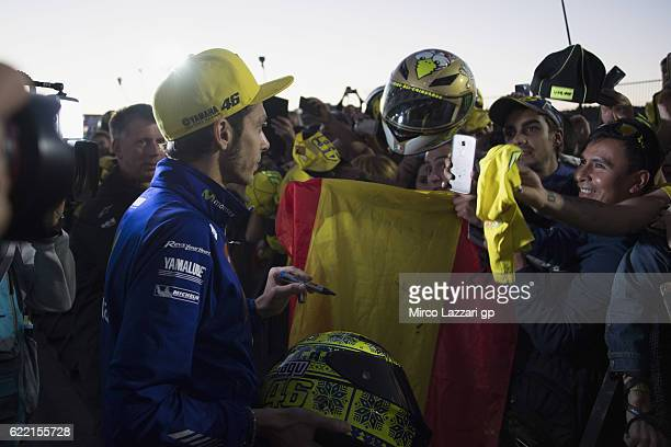 Valentino Rossi of Italy and Movistar Yamaha MotoGP autographs for fans during the pit walk during the MotoGP of Valencia Previews at Ricardo Tormo...