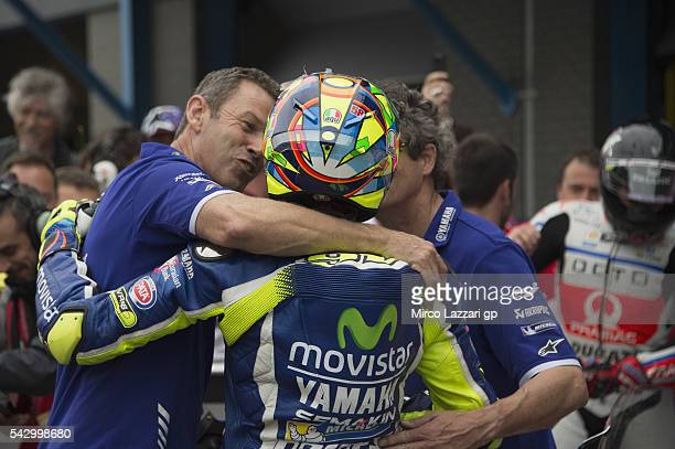 Valentino Rossi of Italy and Movistar Yamaha MotoGP celebrate with team the second place at the end of the qualifying practice during the at MotoGP...