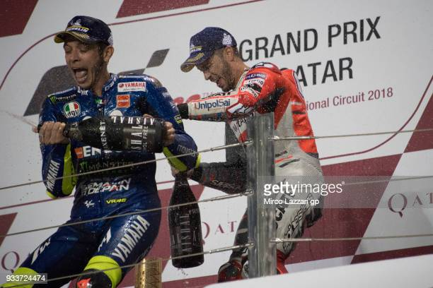 Valentino Rossi of Italy and Movistar Yamaha MotoGP celebrates Andrea Dovizioso of Italy and Ducati Team on the podium at the end of the MotoGP race...