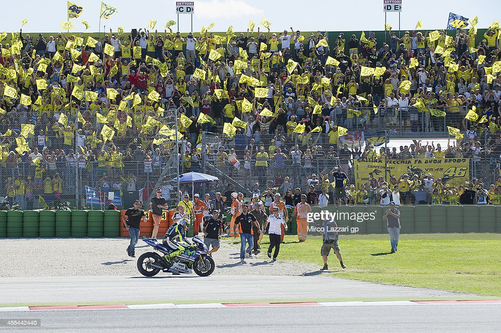 Valentino Rossi of Italy and Movistar Yamaha MotoGP celebrates the victory at the end of the MotoGP race during the MotoGP of San Marino - Race at Misano World Circuit on September 14, 2014 in Misano Adriatico, Italy.