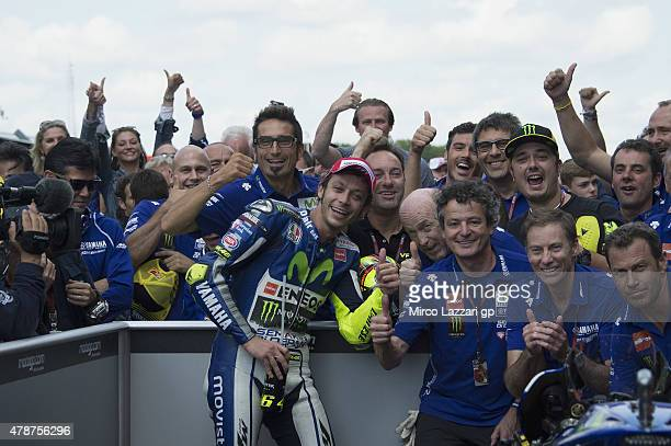 Valentino Rossi of Italy and Movistar Yamaha MotoGP celebrates the victory under the podium with team at the end of the MotoGP race during the MotoGP...