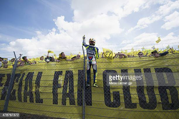Valentino Rossi of Italy and Movistar Yamaha MotoGP celebrates the victory in front of fans at the end of the MotoGP race during the MotoGP...