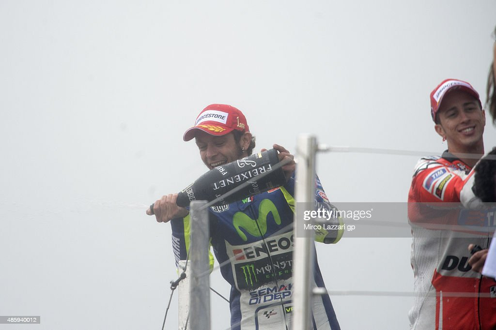 Valentino Rossi of Italy and Movistar Yamaha MotoGP celebrates the victory with champagne at the end of the MotoGP race during the MotoGp Of Great Britain - Race at Silverstone Circuit on August 30, 2015 in Northampton, United Kingdom.
