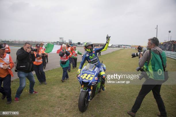 Valentino Rossi of Italy and Movistar Yamaha MotoGP celebrates the victory with fans at the end of the MotoGP Race during the MotoGP Netherlands...