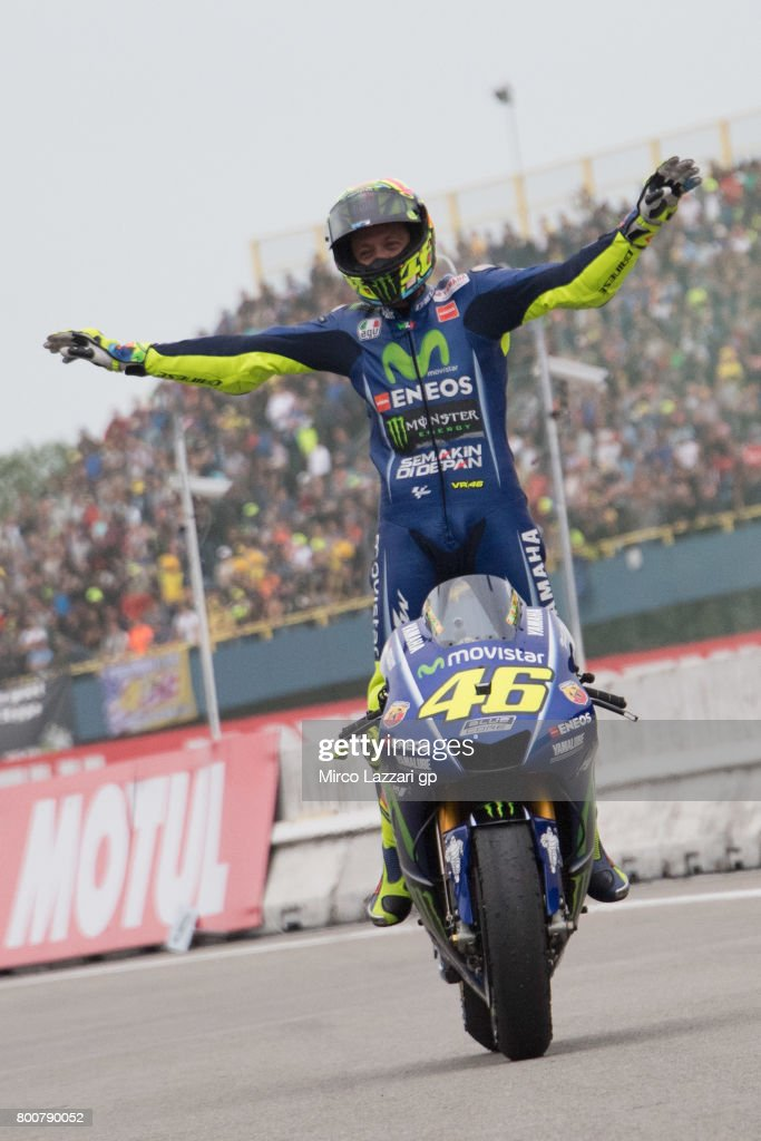 Valentino Rossi of Italy and Movistar Yamaha MotoGP celebrates the victory and arrives under the podium at the end of the MotoGP Race during the MotoGP Netherlands - Race on June 25, 2017 in Assen, Netherlands.