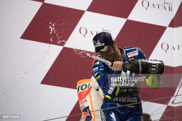 Valentino Rossi of Italy and Movistar Yamaha MotoGP celebrates with champagne on the podium at the end of the MotoGP race during the MotoGP of Qatar...