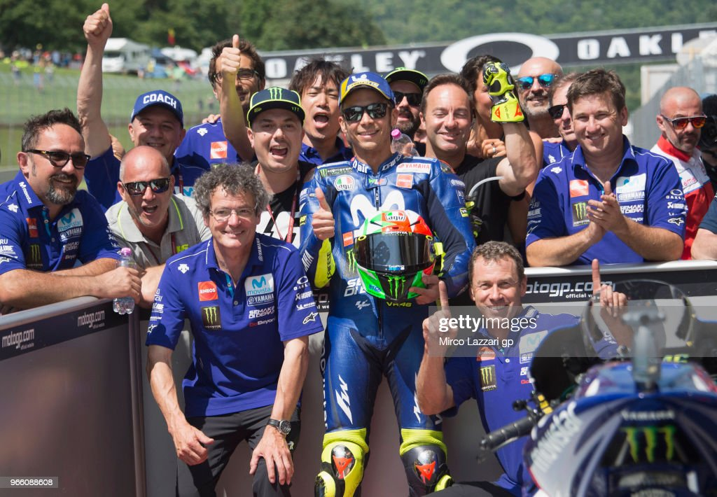 Valentino Rossi of Italy and Movistar Yamaha MotoGP celebrates with team the MotoGP pole position at the end of the qualifying practice during the MotoGp of Italy - Qualifying at Mugello Circuit on June 2, 2018 in Scarperia, Italy.