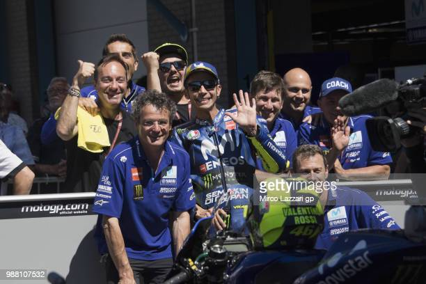 Valentino Rossi of Italy and Movistar Yamaha MotoGP celebrates with team the third place at the end of the MotoGP Qualifying practice during the...