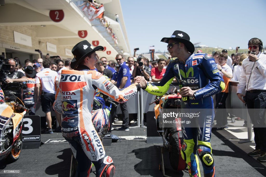 Valentino Rossi of Italy and Movistar Yamaha MotoGP congratulates under the podium with Marc Marquez of Spain and Repsol Honda Team (L) at the end of the MotoGP race during the MotoGp Red Bull U.S. Grand Prix of The Americas - Race at Circuit of The Americas on April 23, 2017 in Austin, Texas.