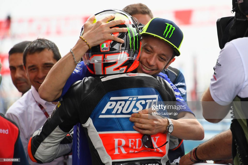 Valentino Rossi (R) of Italy and Movistar Yamaha MotoGP congratulates with Marco Bezzecchi of Italy and Pruestel GP KTM for the victory at the end of the Moto3 race during the MotoGp of Argentina - Race on April 8, 2018 in Rio Hondo, Argentina.