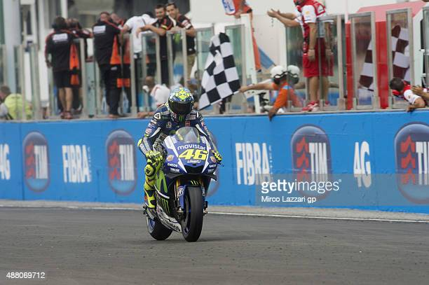 Valentino Rossi of Italy and Movistar Yamaha MotoGP cuts the finish lane at the end of the MotoGP World Championship race during the San Marino GP at...