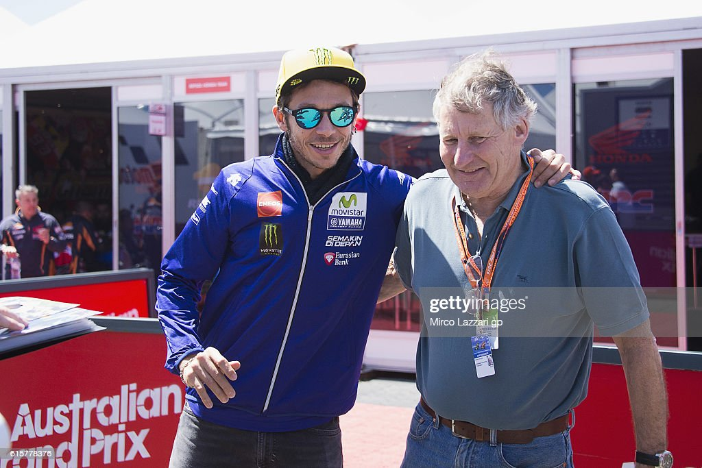 Valentino Rossi of Italy and Movistar Yamaha MotoGP greets Geremy Burgess of Australia in paddock during previews ahead of the 2016 MotoGP of Australia at Phillip Island Grand Prix Circuit on October 20, 2016 in Phillip Island, Australia.