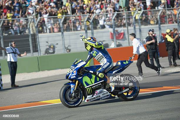 Valentino Rossi of Italy and Movistar Yamaha MotoGP greets the fans at the end of the MotoGP race during the MotoGP of Valencia Race at Ricardo Tormo...