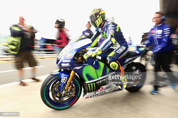 Valentino Rossi of Italy and Movistar Yamaha MotoGP heads out onto the track from pit lane during free practice for the 2015 MotoGP of Australia at...