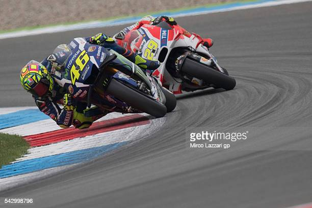 Valentino Rossi of Italy and Movistar Yamaha MotoGP leads Andrea Iannone of Italy and Ducati Team during the qualifying practice during the at MotoGP...