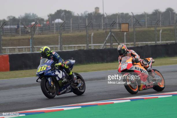 Valentino Rossi of Italy and Movistar Yamaha MotoGP leads Dani Pedrosa of Spain and Repsol Honda Team during the qualifying practice during the...