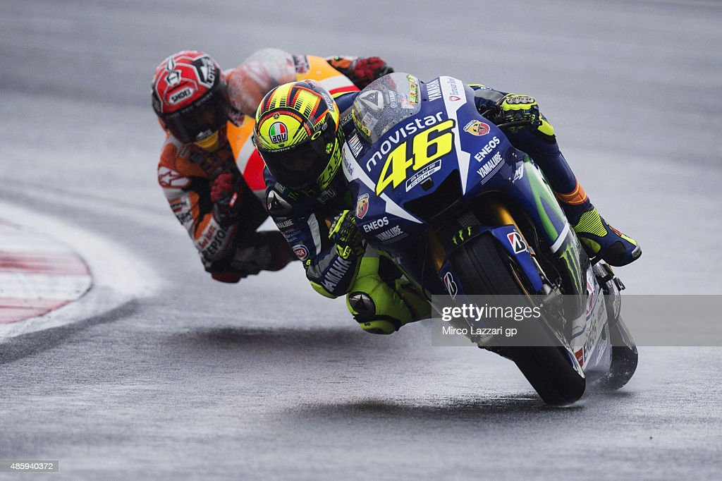 Valentino Rossi of Italy and Movistar Yamaha MotoGP leads Marc Marquez of Spain and Repsol Honda Team during the MotoGP race during the MotoGp Of Great Britain - Race at Silverstone Circuit on August 30, 2015 in Northampton, United Kingdom.
