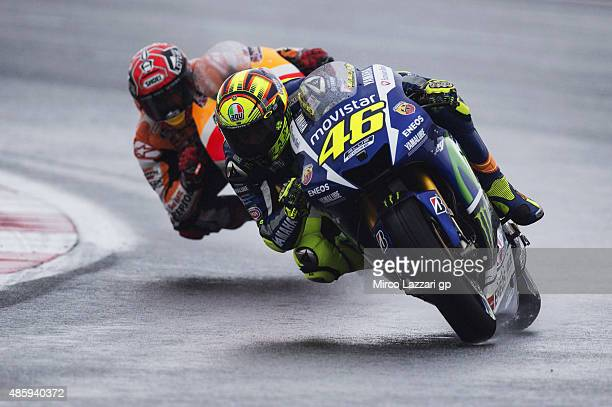 Valentino Rossi of Italy and Movistar Yamaha MotoGP leads Marc Marquez of Spain and Repsol Honda Team during the MotoGP race during the MotoGp Of...