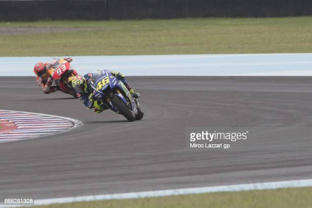 Valentino Rossi of Italy and Movistar Yamaha MotoGP leads Marc Marquez of Spain and Repsol Honda Team during the MotoGp of Argentina Qualifying on...