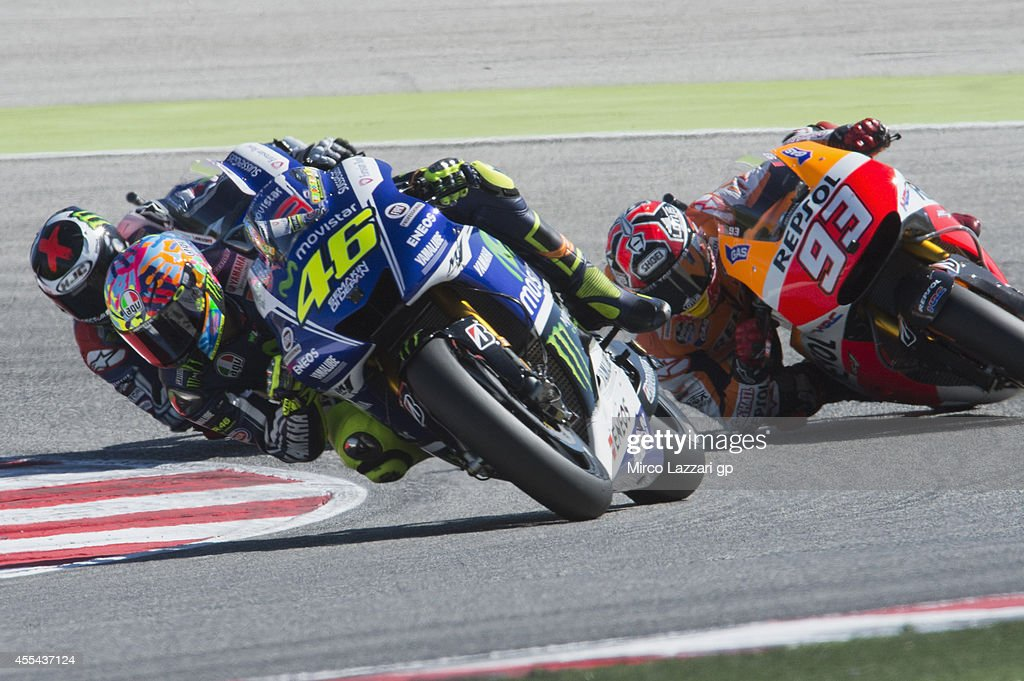 Valentino Rossi of Italy and Movistar Yamaha MotoGP leads the field during the MotoGP race during the MotoGP of San Marino - Race at Misano World Circuit on September 14, 2014 in Misano Adriatico, Italy.